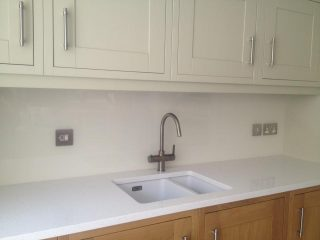 White coloured glass splashback