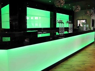 Illuminated green splashback