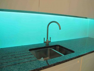 light blue illuminated splashbacks