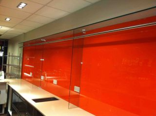Orange glass splashback for shop display - Glass360.co.uk