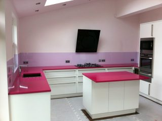 purple glass splashback & pink glass worktop