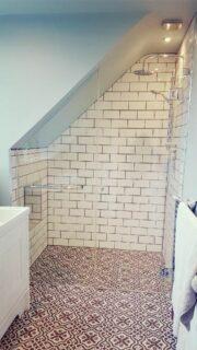 custom shower glass for sloped loft ceiling