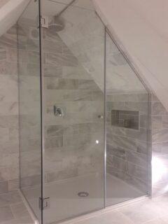 Frameless loft showers