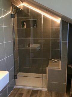 designer loft shower enclosure with tile seat - sloping ceiling